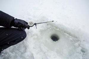 man-holding-ice-fishing-rod-and-jiggying